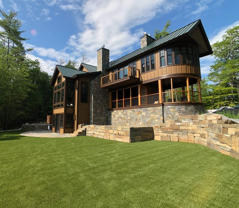 Putnam Station, NY, winter home backyard featuring GolfGreens® Pro Putt & Chip and DuPont™ ForeverLawn® Select EL