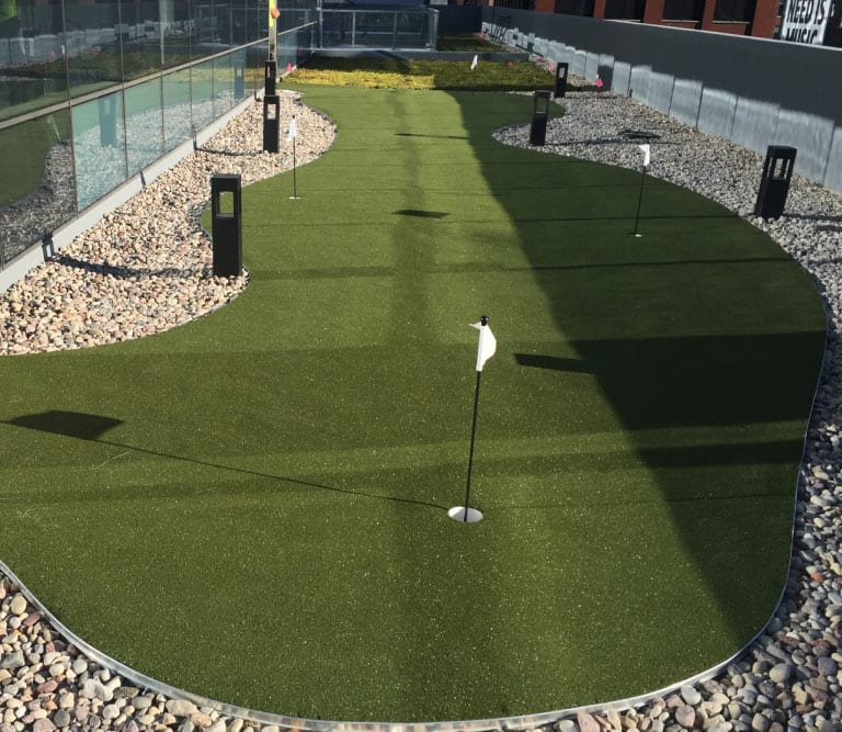 Chicago outdoor balcony space with a GolfGreens putting green installed by ForeverLawn Chicago