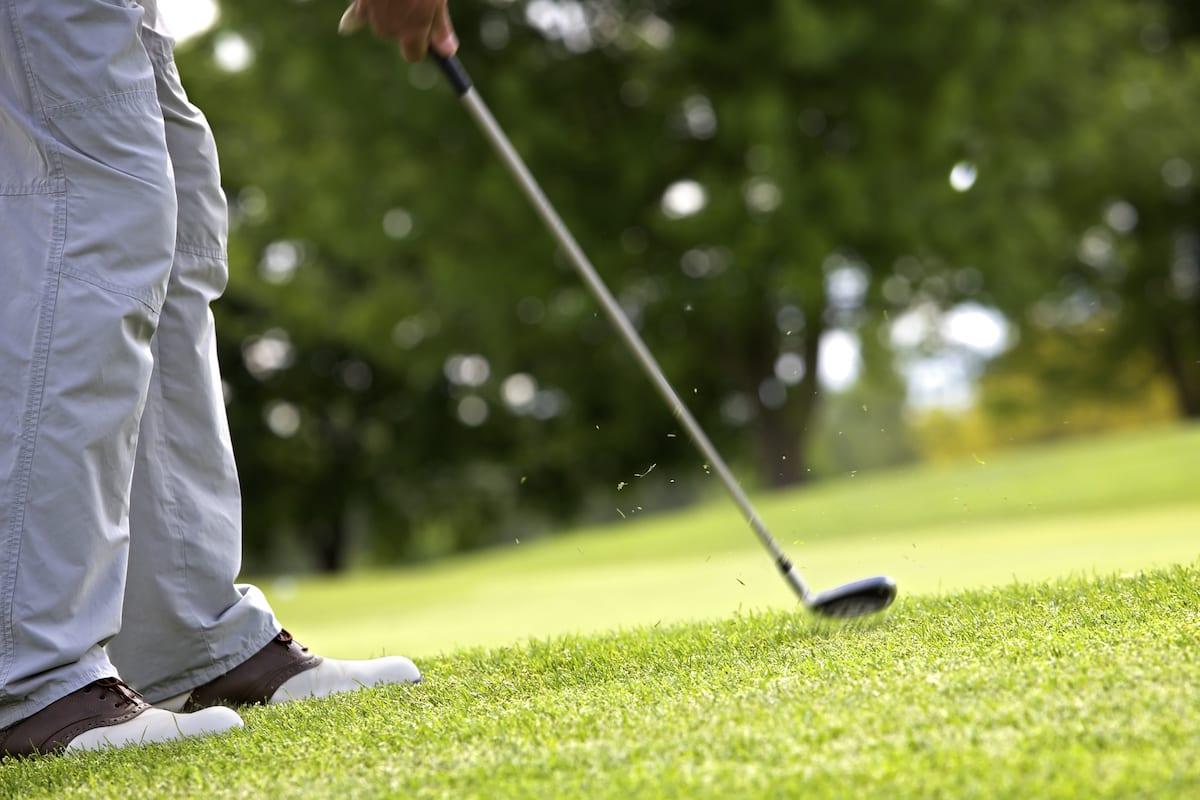 Golfer taking pitch shot