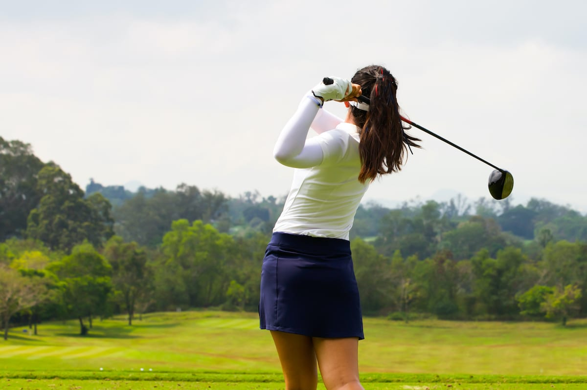 Female golfer hitting a draw and fade