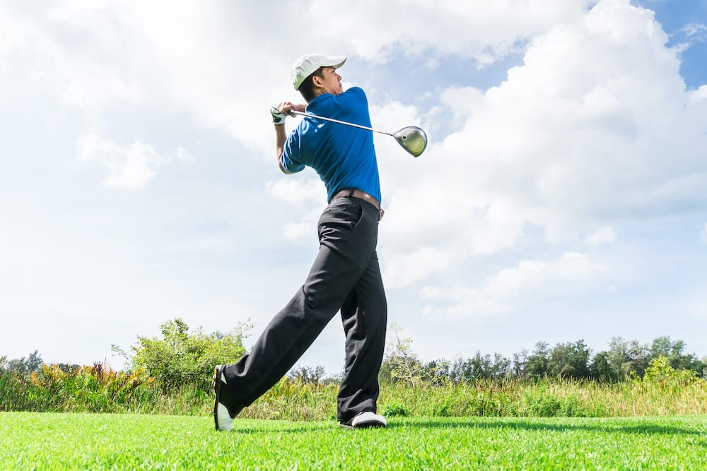 Golfer using driver to drive the ball further