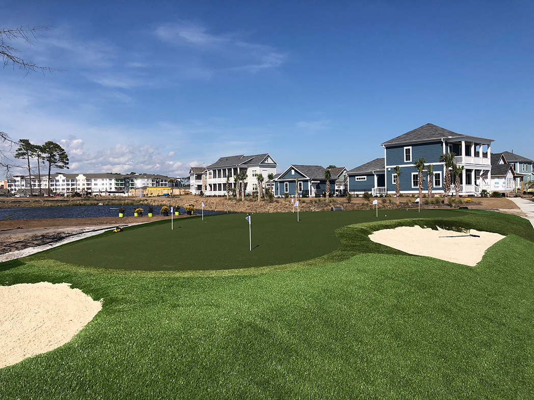 Putting green featuring GolfGreens® Pro Putt & Chip, Fringe, and DuPont™ ForeverLawn® Select HD at Living Dunes residential community in Myrtle Beach, SC