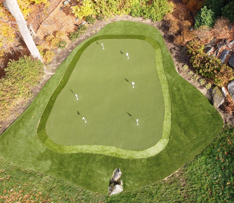 Backyard putting green in Greenwich, CT, featuring GolfGreens synthetic turf by ForeverLawn